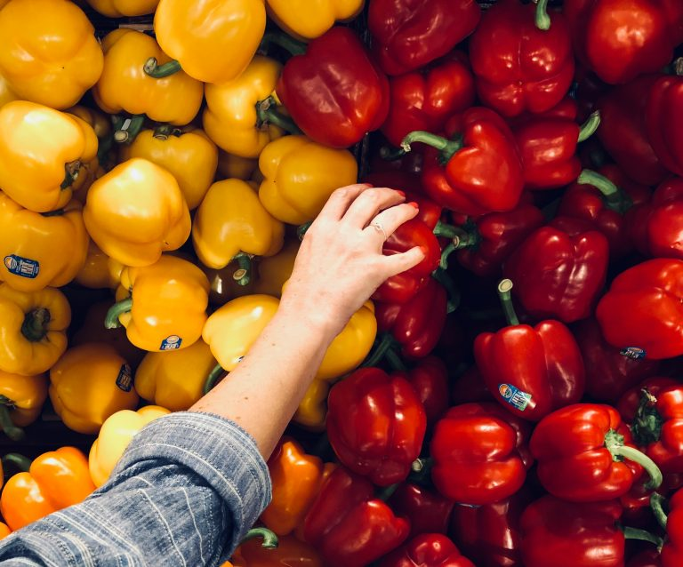 shopping for healthy foods red and yellow peppers